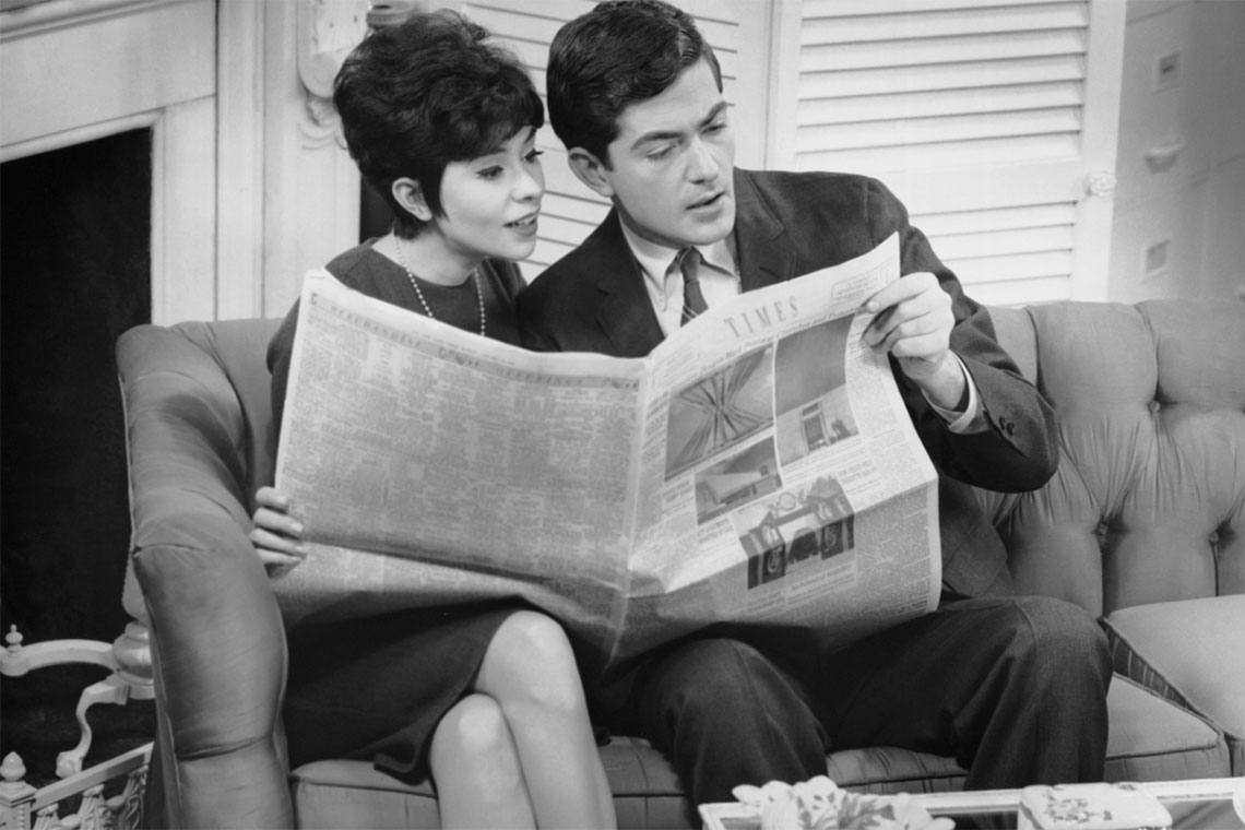 couple reading the Times newspaper
