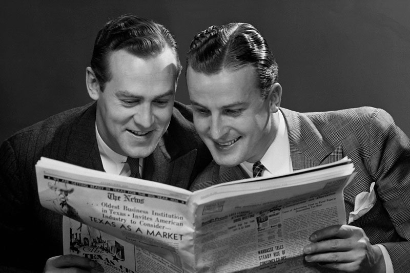 men reading newspaper