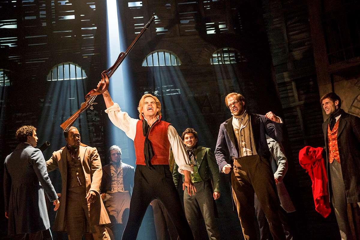 Matt Shingledecker and the touring cast of Les Miserables.