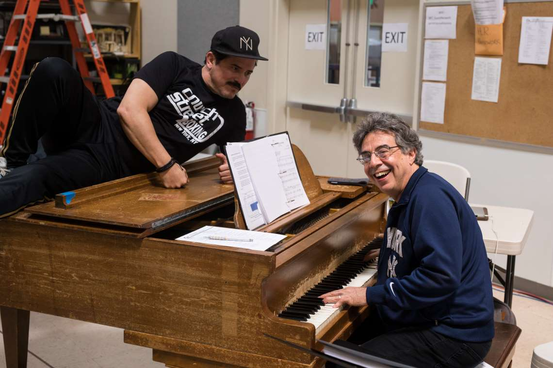 Tony Taccone and John Leguizamo in the rehearsal room for Kiss My Aztec!