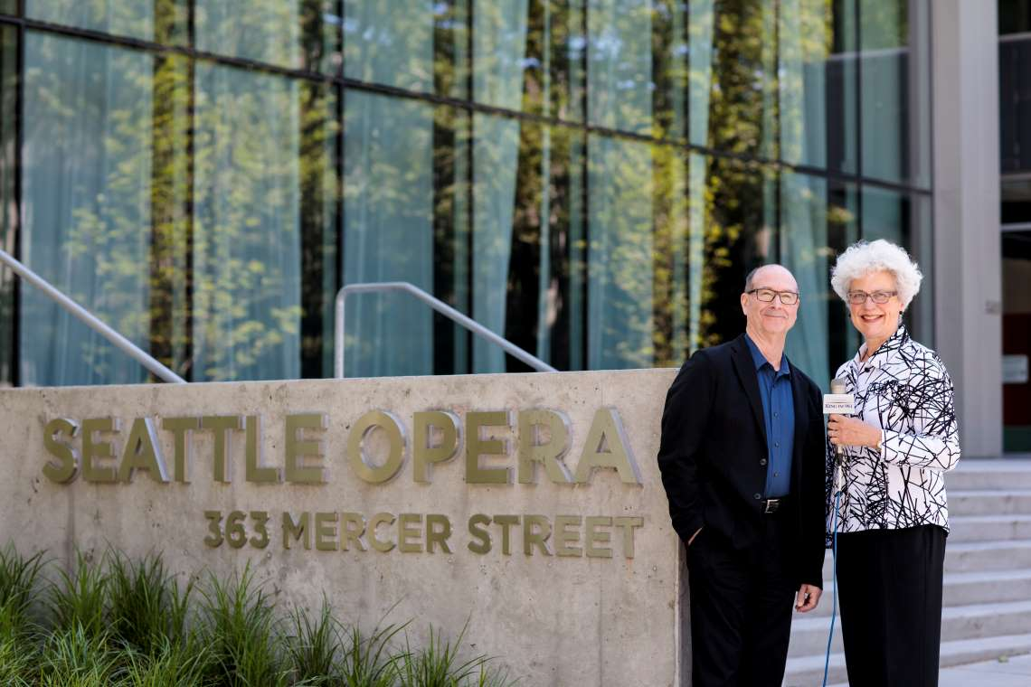 KING FM announcers Lisa Bergman and Mike Brooks in front of the Opera Center.