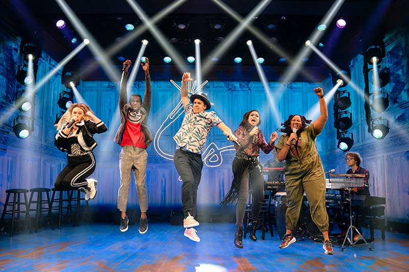 (L-R) Kaila Mullady, Utkarsh Ambudkar, Anthony Veneziale, Ashley Pérez Flanagan, Aneesa Folds, Kurt Crowley (on keyboard back), and Arthur Lewis (on keyboard front) from the recent sold-out Broadway engagement of Freestyle Love Supreme.