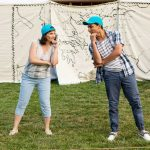 Kelly Karcher and Rico Lastrapes in The Comedy of Errors performing in a park